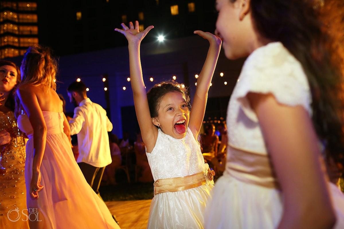 cute kid flower girl red tongue sticking out, garden wedding reception, Iberostar Cancun, Mexico