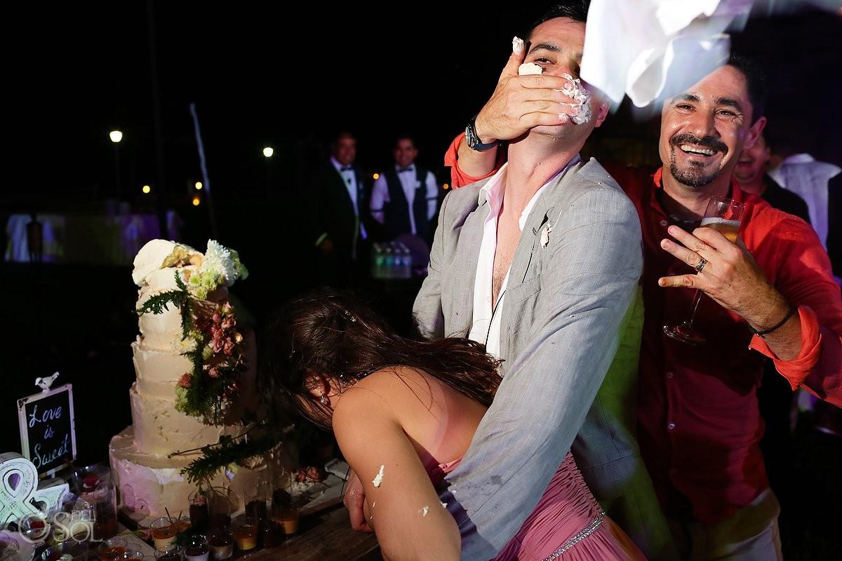 cake smash throwing napkin garden wedding reception, Iberostar Cancun, Mexico