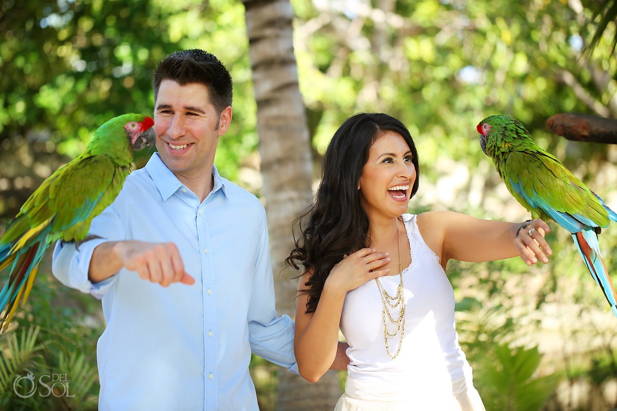 Couple laughing holding green parrot, IntraAwareness Commercial shoot, portraits Isla Blanca, Cancun