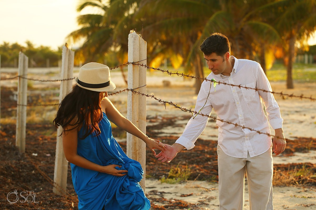 crossing borders, overcoming challenges, couple crossing barbed wire fence, sunset IntraAwareness Commercial shoot, portraits Isla Blanca, Cancun
