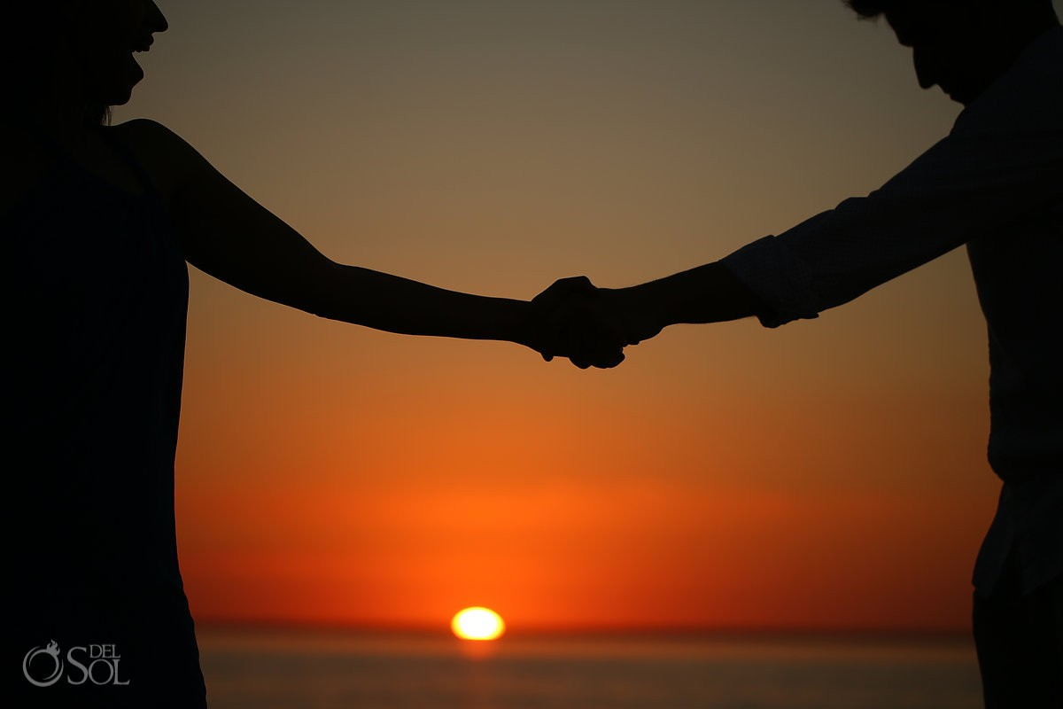 Sunset holding hands, togetherness, IntraAwareness Commercial shoot, portraits Isla Blanca, Cancun