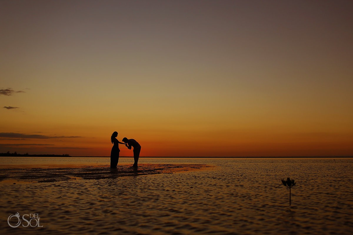Sunset silouette kissing hand, IntraAwareness Commercial shoot, portraits Isla Blanca, Cancun