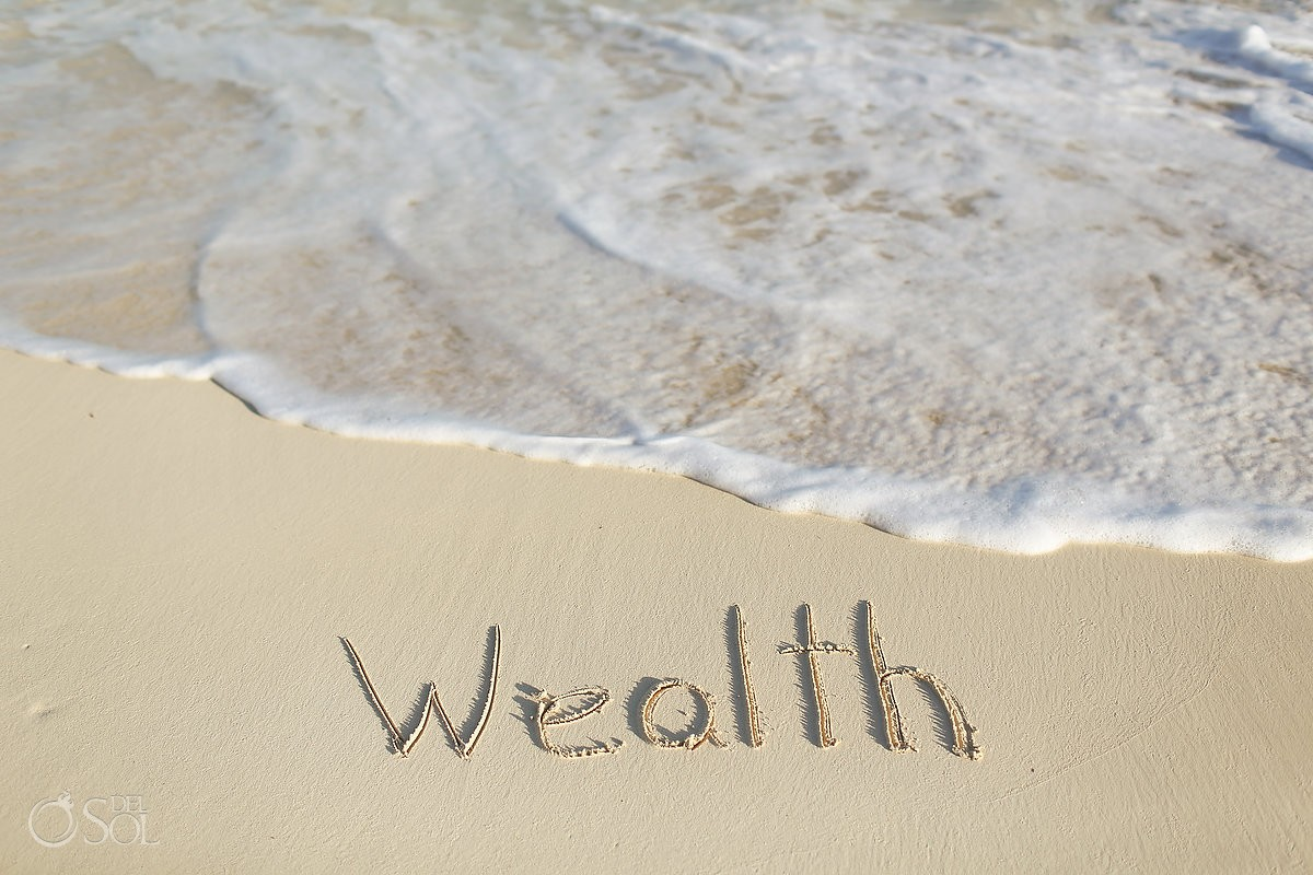 wealth word written white sand beach, ocean, IntraAwareness Commercial shoot, portraits Isla Blanca, Cancun