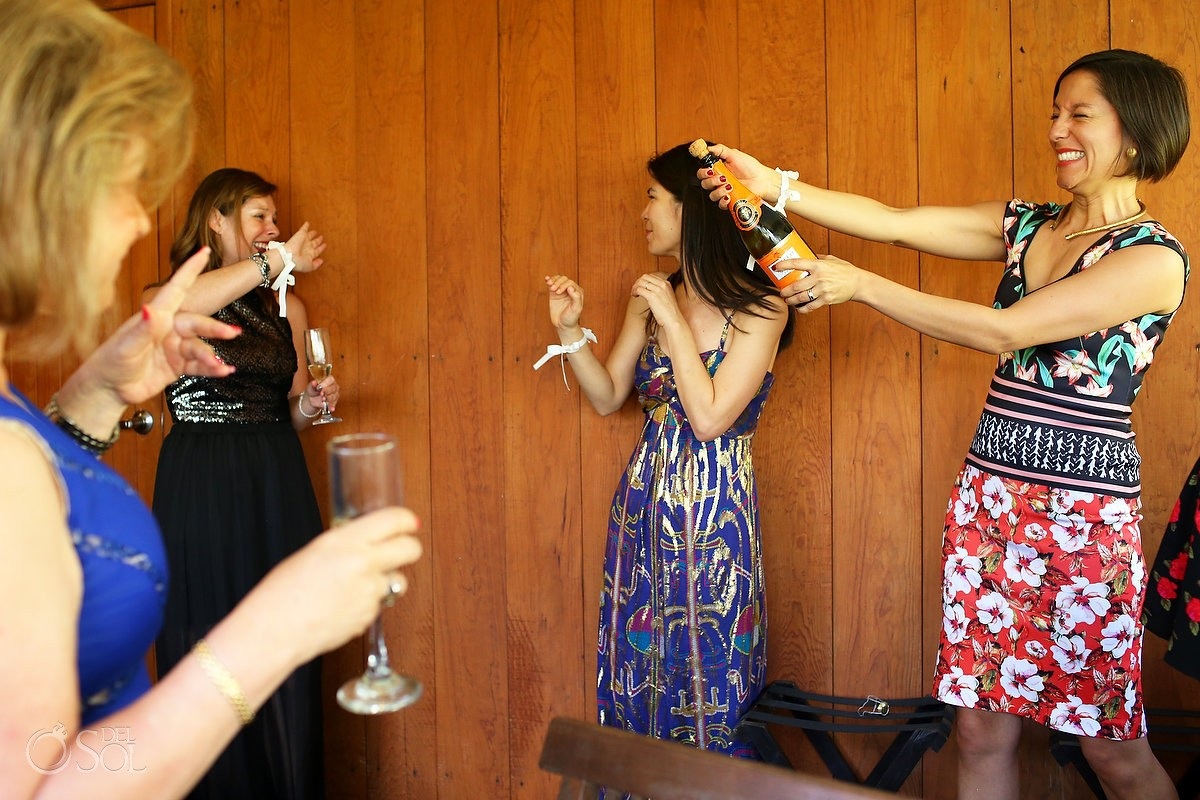 bride getting ready opening champagne, funny wedding picture