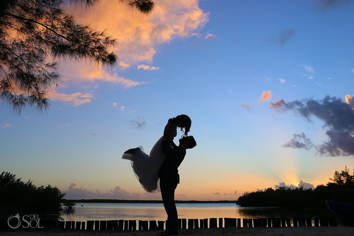 cute jumping lift silhouette sunset portraits destination wedding Isla La Pasion, Cozumel, Mexico