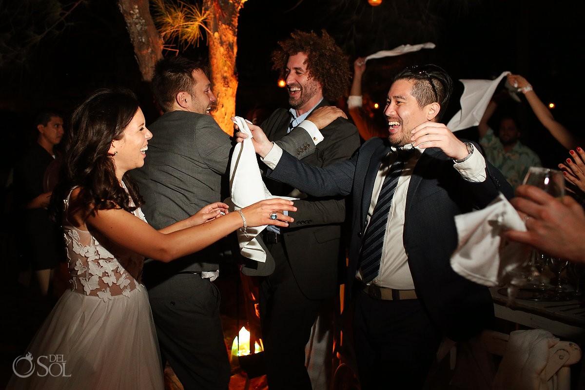 happy couple enters wedding reception Isla La Pasion, Cozumel, Mexico
