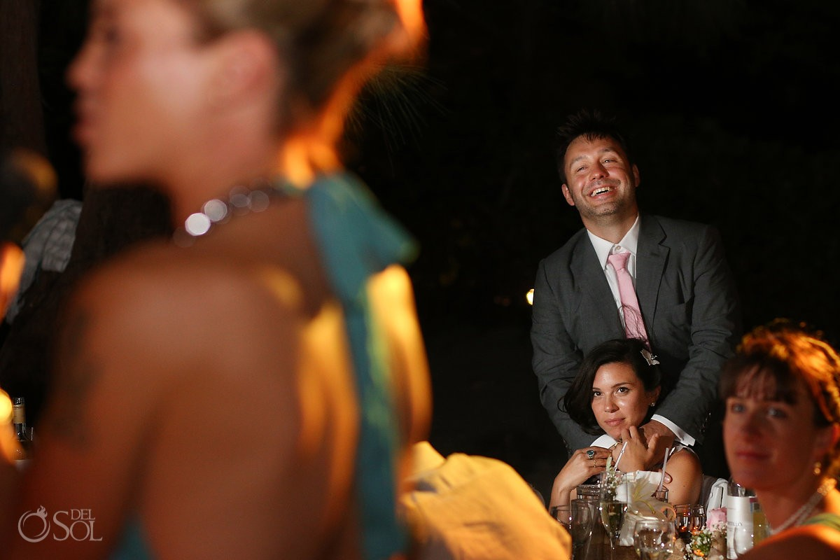 bride groom hug watching speeches, Caribbean Island Wedding reception, Isla Pasion Cozumel Mexico