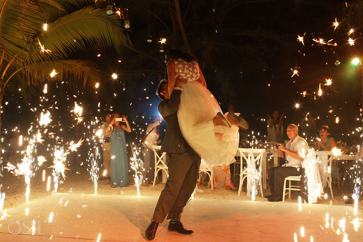 Groom lifts bride first dance, fireworks Caribbean Island Wedding reception, Isla Pasion Cozumel Mexico