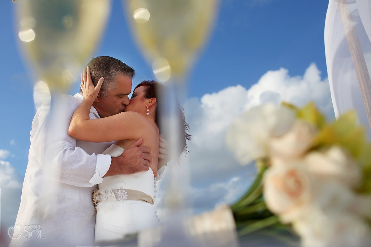 creative wedding portrait, champagne glasses, blue sky, Beach Wedding Elopement Paradisus, Playa del Carmen, Mexico