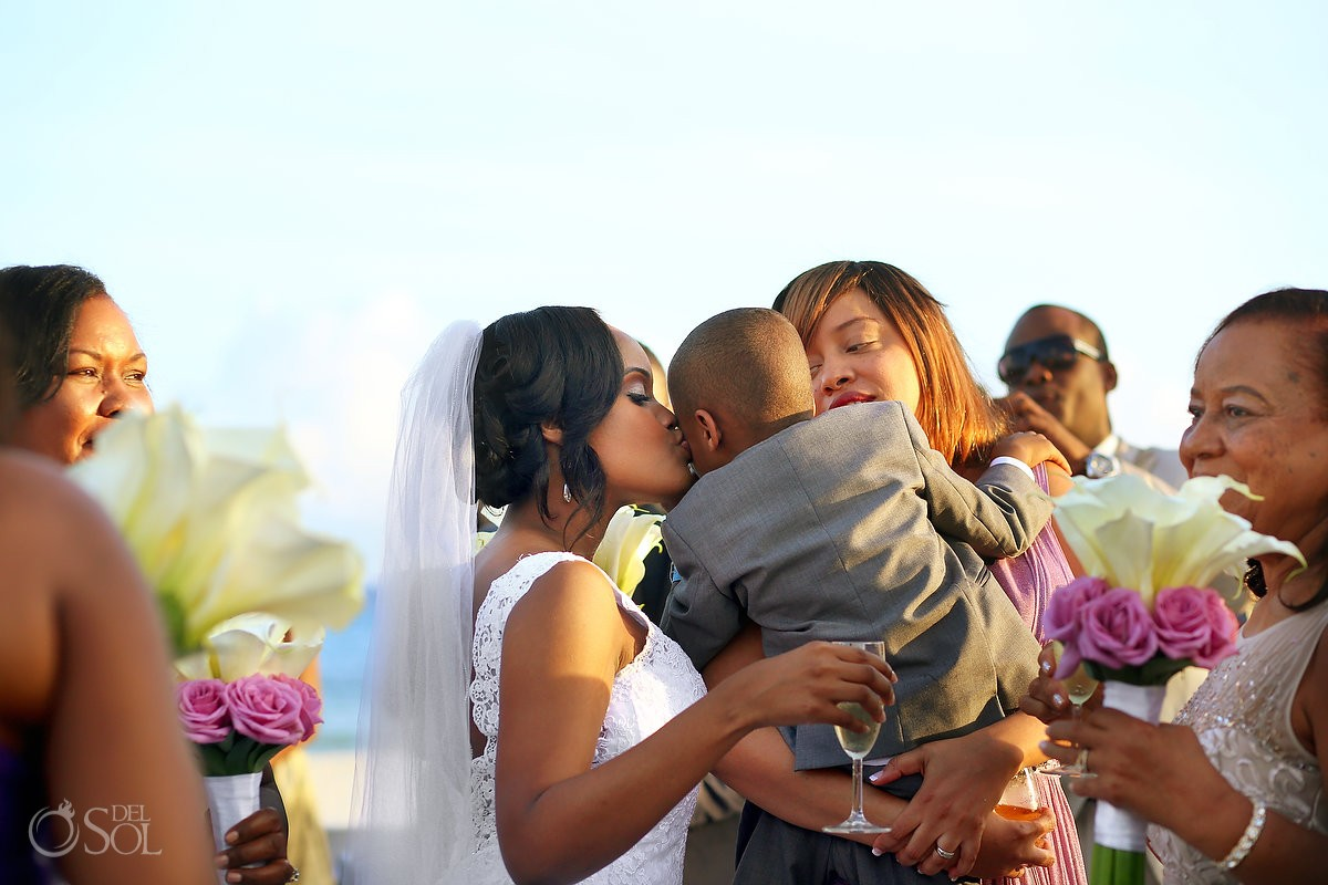 bride kissing ring bearer, cute family love, Destination Wedding Sandos Playacar, Playa del Carmen, Mexico
