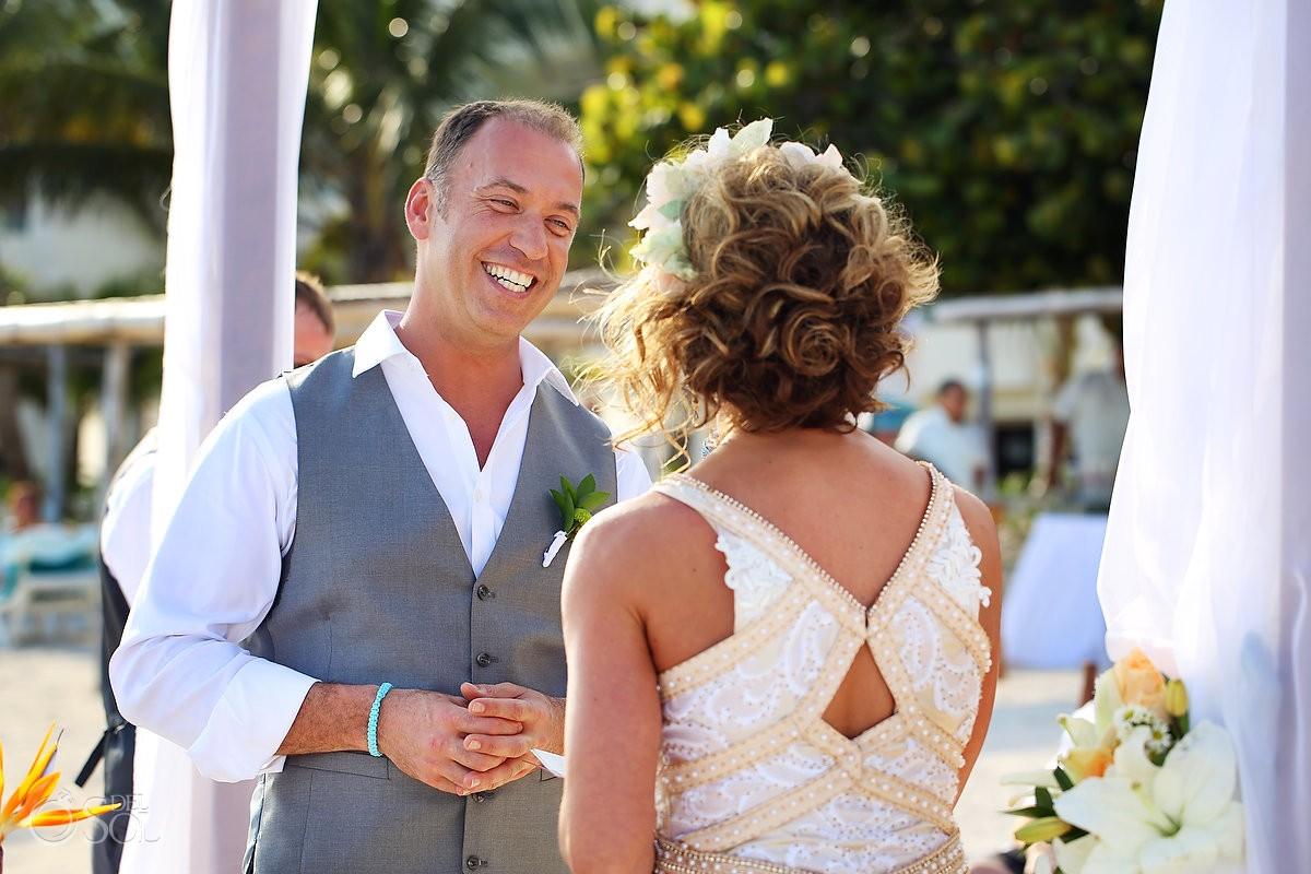 groom smiling at akumal bay resort mexico destination wedding