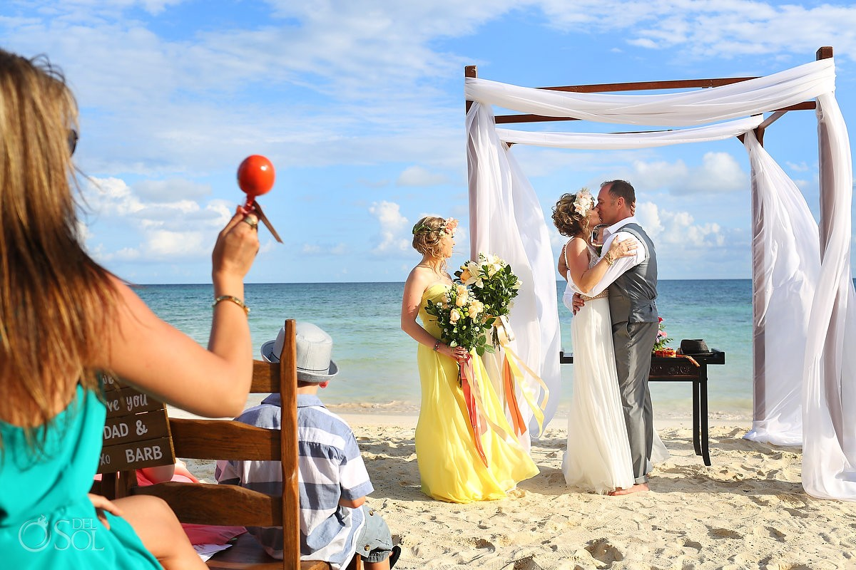 maracas during first kiss at akumal bay resort mexico destination wedding