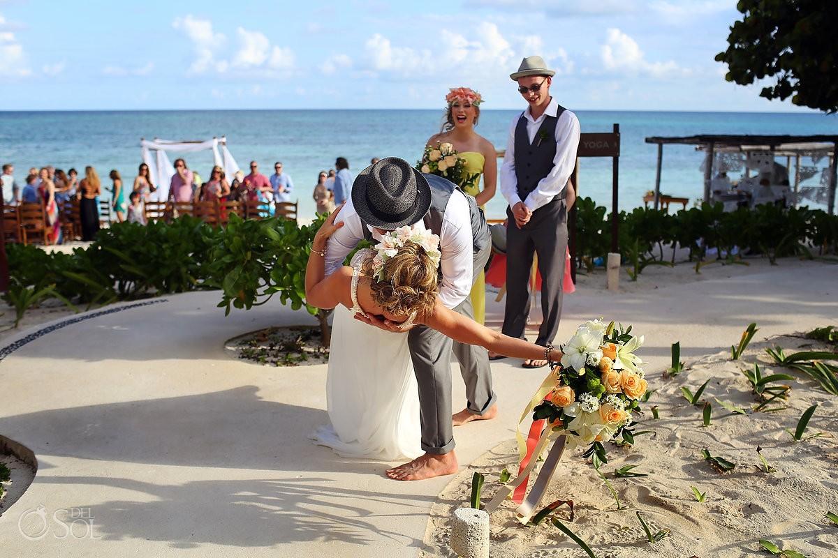 dip kiss with bride and groom at Akumal Bay Beach destination wedding