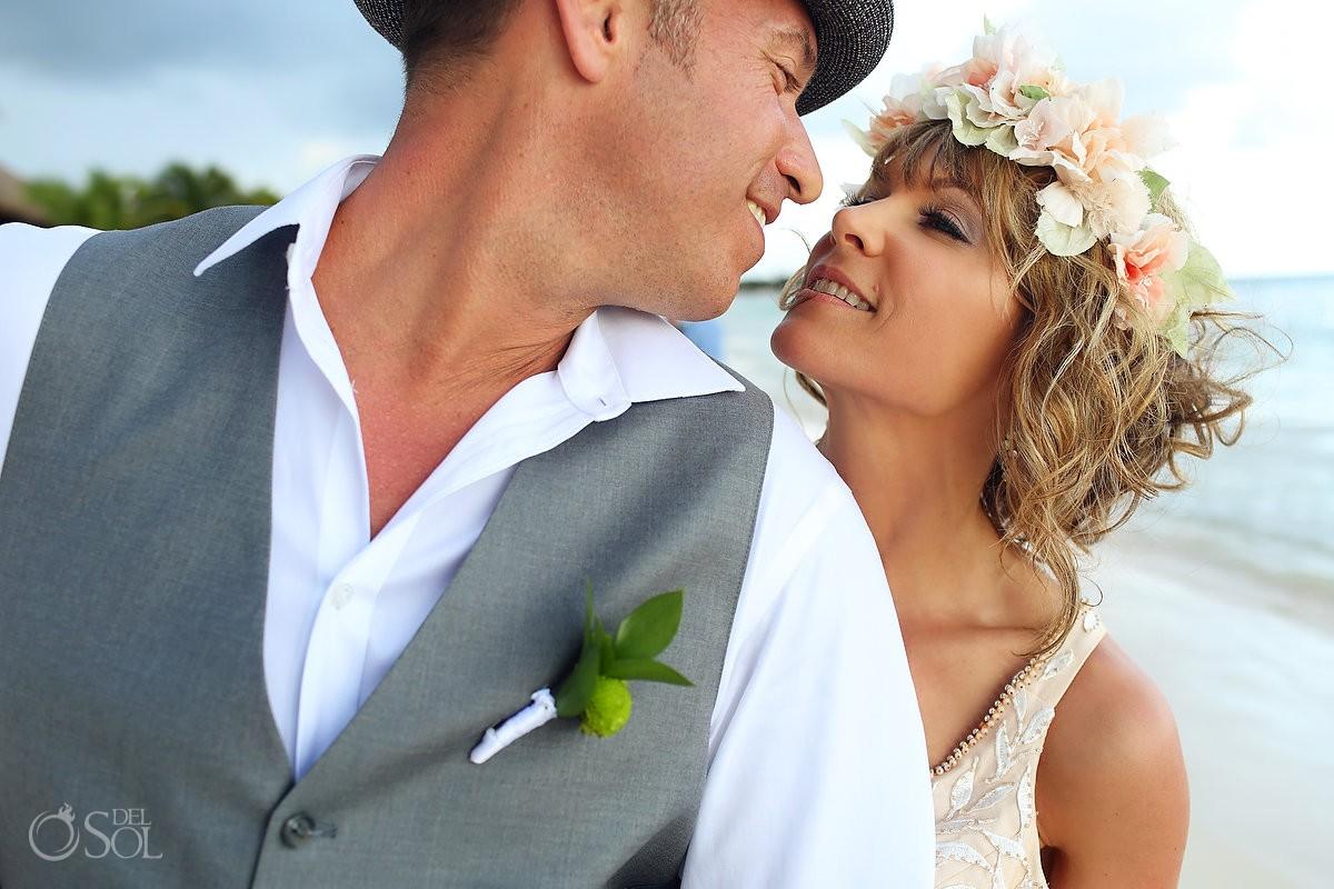 bride and groom kiss portrait at Akumal Bay Beach destination wedding
