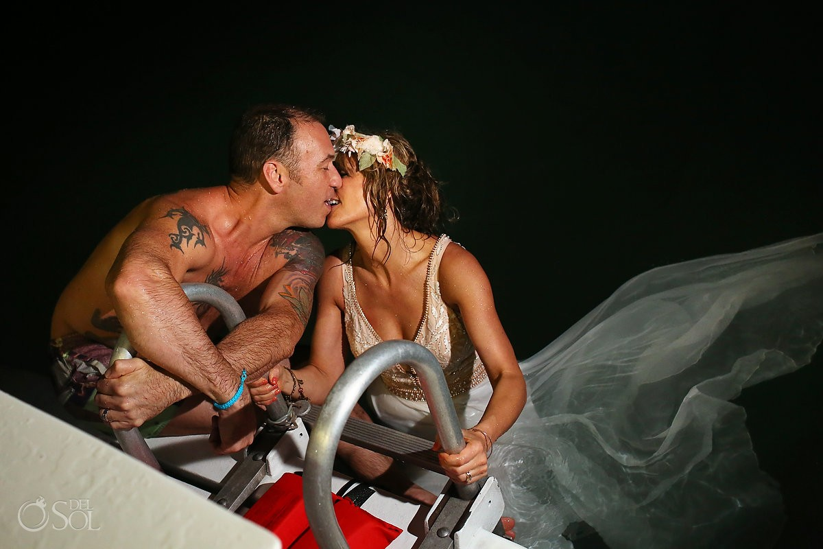 bride and groom at wedding kissing on h2o cruises private charter