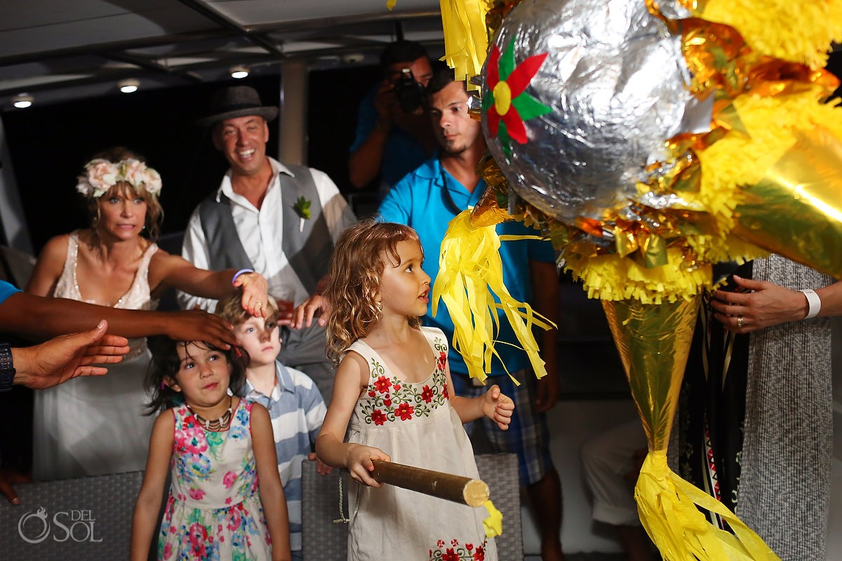 wedding flower girl hitting Piñata on h2o cruises private charter