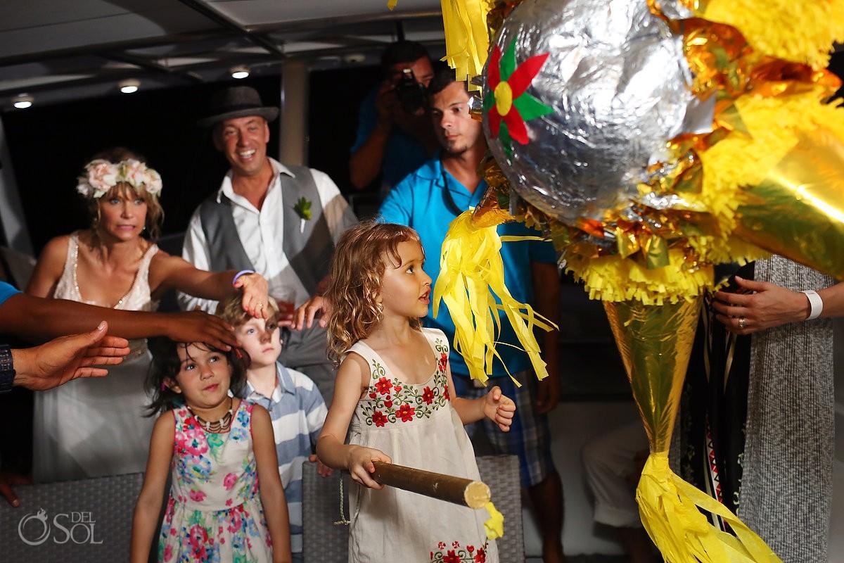 wedding flower girl hitting Piñata on h2o cruises private charter