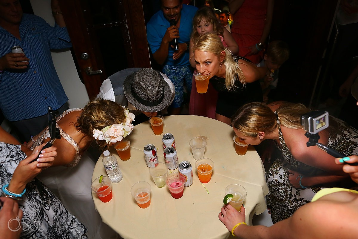 weddings guests at reception doing shots on h2o cruises private charter