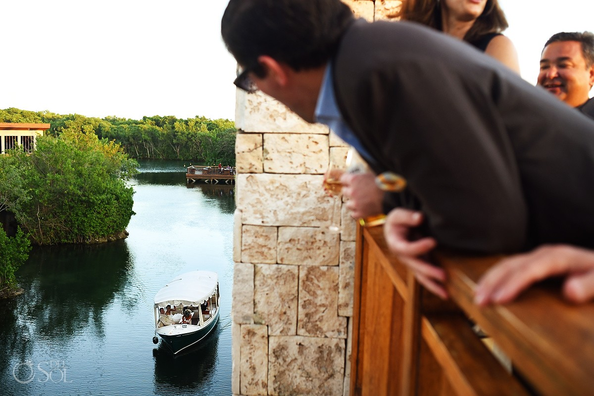bride groom arrive wedding ceremony canal boat, guests watching, Gazebo Wedding Banyan Tree Mayakoba, Playa del Carmen, Mexico