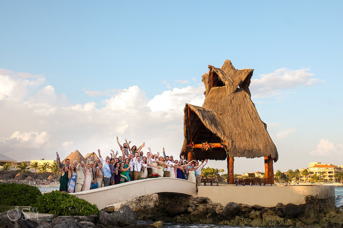 group fun formal wedding portrait bridge Dreams Puerto Aventuras Gazebo, sunset golden hour