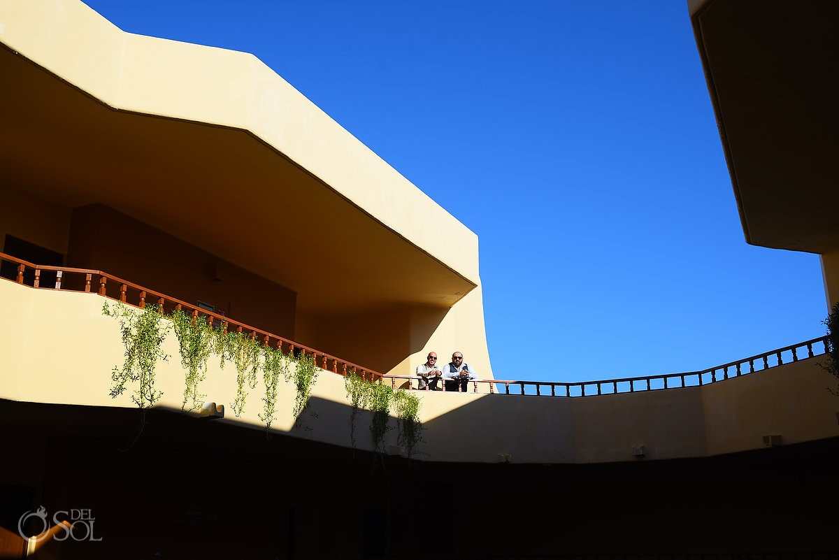 architectural graphic wedding portrait groom getting ready blue sky, Fiesta Americana Condesa, Cancun, Mexico