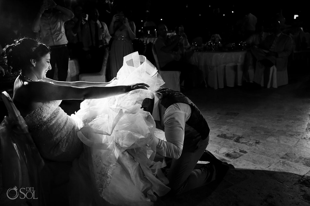 groom under bride wedding dress garter, black white monochrome, wedding reception main pool Fiesta Americana Condesa, Cancun Mexico