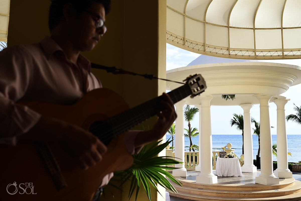 musician playing guitar Barceló Maya Palace Deluxe gazebo wedding set up, Riviera Maya, Mexico