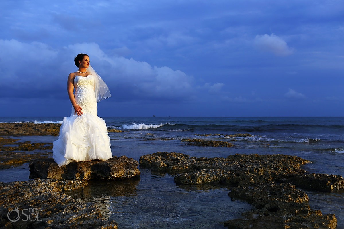 wedding portrait, blue sky gloden light bride rocks ocean, Barceló Maya Palace Deluxe wedding, Riviera Maya, Mexico