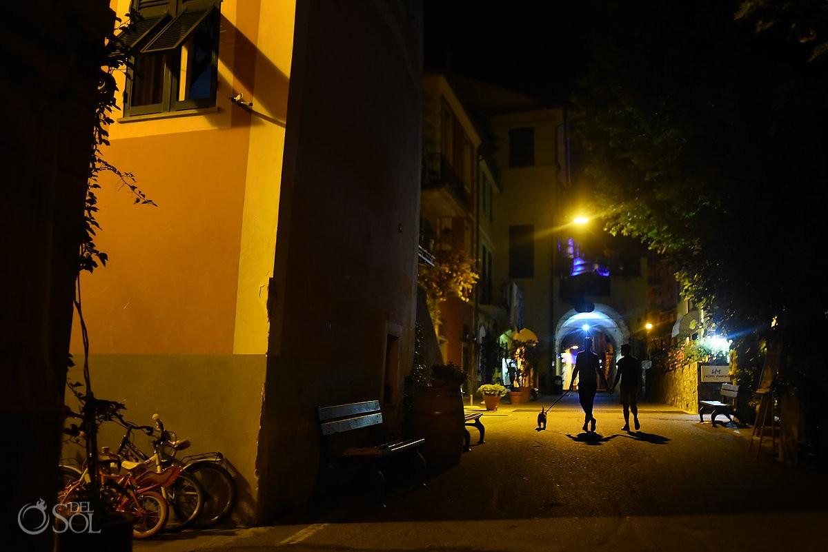 same sex couple at night in Via dell'Amore, Cinque Terre Italy
