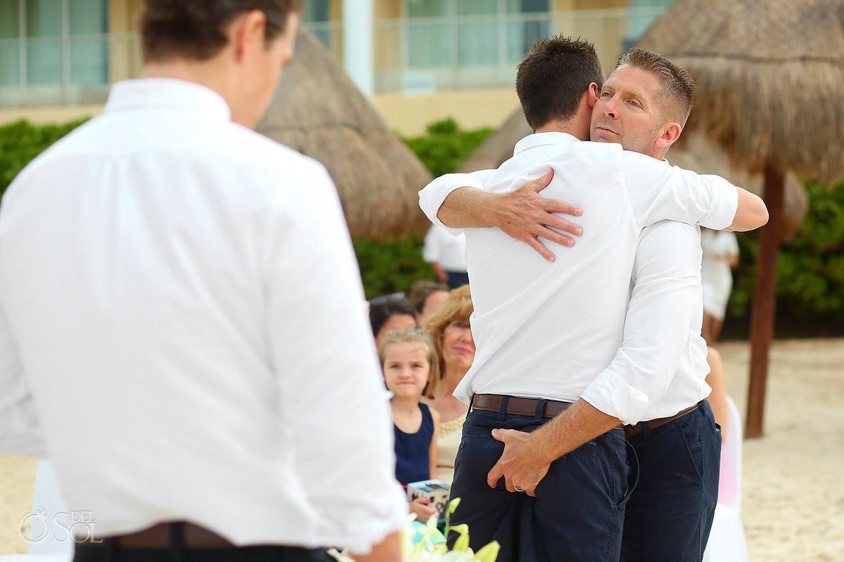 processional funny groomsman hug butt ass grab, beach Wedding Now Jade, Puerto Morelos, Mexico