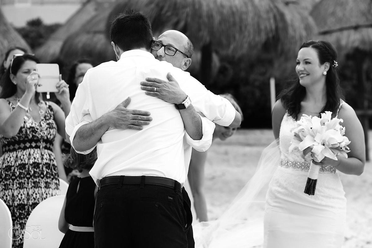 father of bride hugs groom, Beach Wedding Now Jade, Puerto Morelos, Mexico.