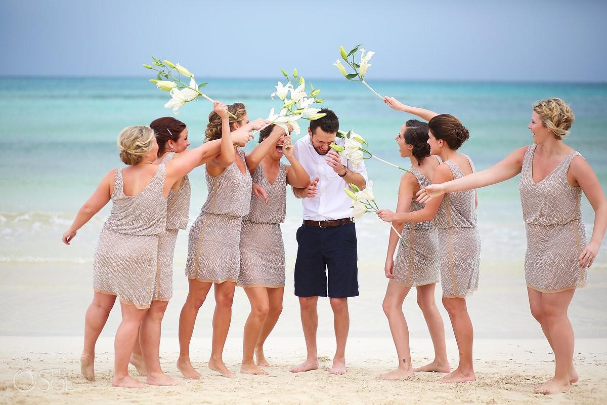 funny wedding picture bridesmaids hit groom flower bouquet, Beach Wedding Now Jade, Puerto Morelos, Mexico.