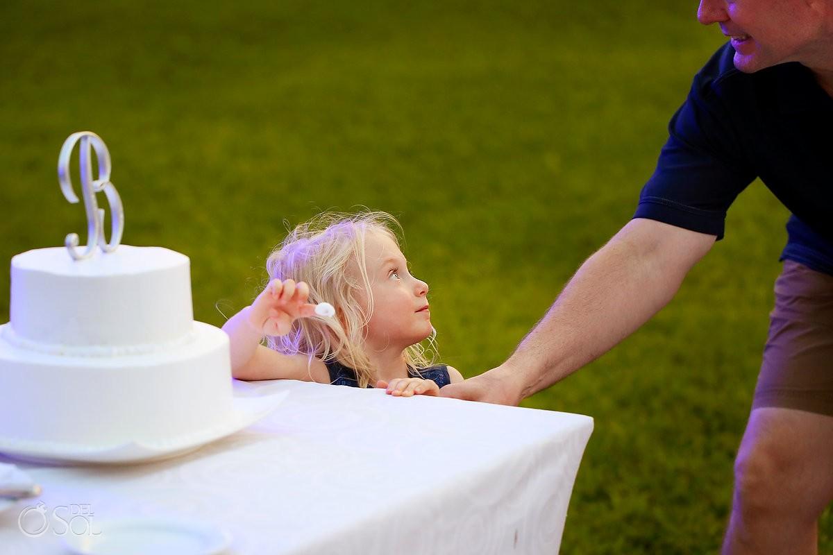 cute blond flower girl stealing cake icing finger, garden wedding reception, Now Jade, Puerto Morelos, Mexico