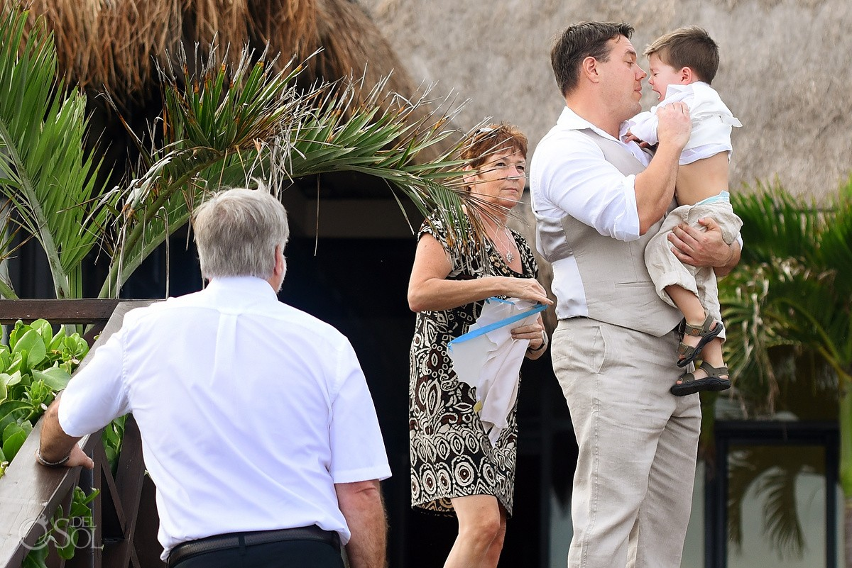groom mother holding crying son, beach wedding Now Sapphire Riviera Cancun, Mexico