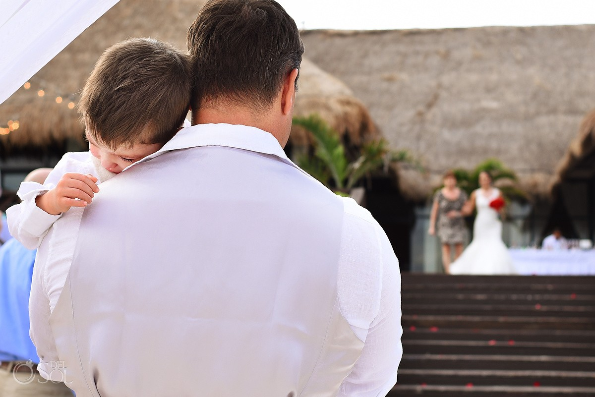 groom holding son bride entrance, beach wedding Now Sapphire Riviera Cancun, Mexico