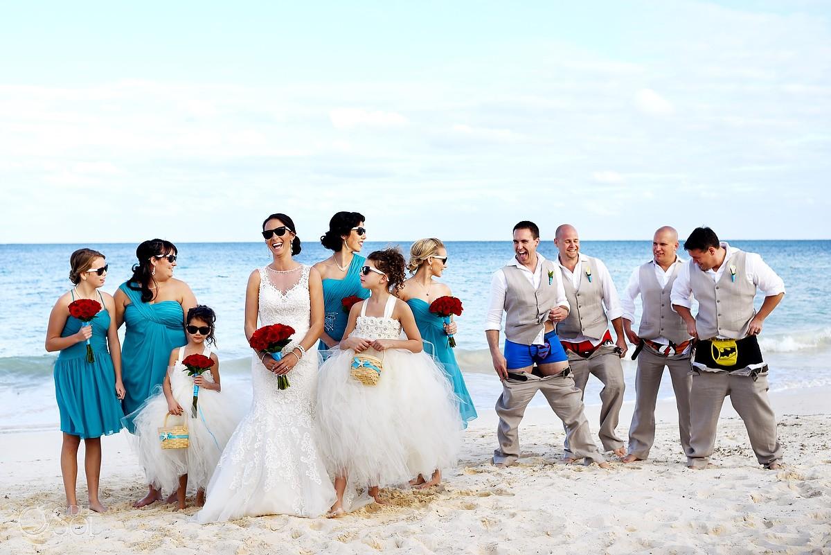 funny wedding photo groom groomsmen drop trousers superhero pants boxers, beach Wedding Now Sapphire, Puerto Morellos, Mexico