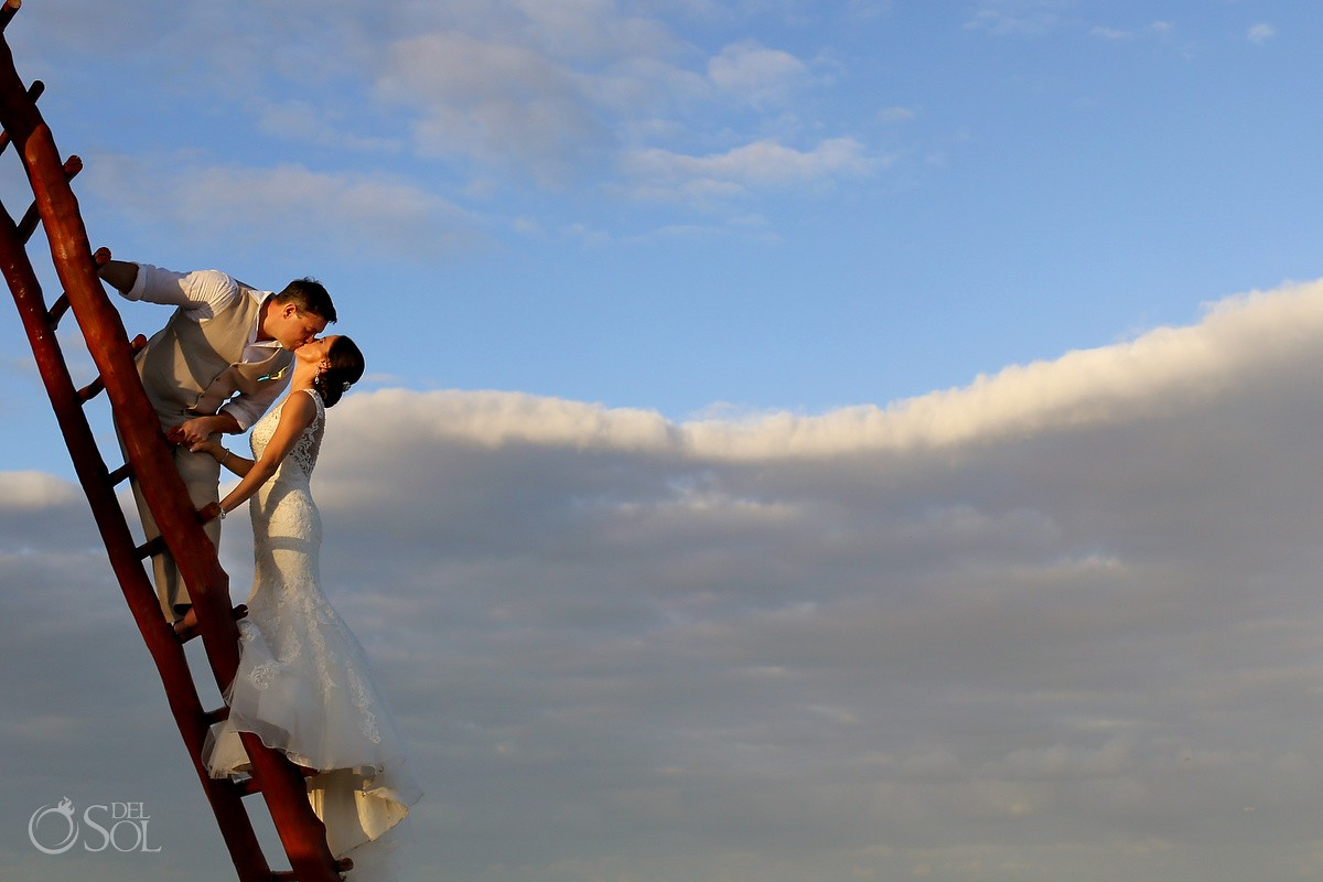 bride groom clouds sky ladder, creative wedding portrait, beach Wedding Now Sapphire, Puerto Morellos, Mexico