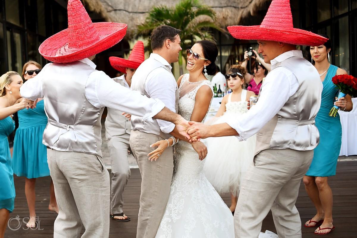 bride groom dancing surrounded groomsmen red sombreros, Wedding reception entrance Now Sapphire Tequila terrace, Puerto Morellos, Mexico