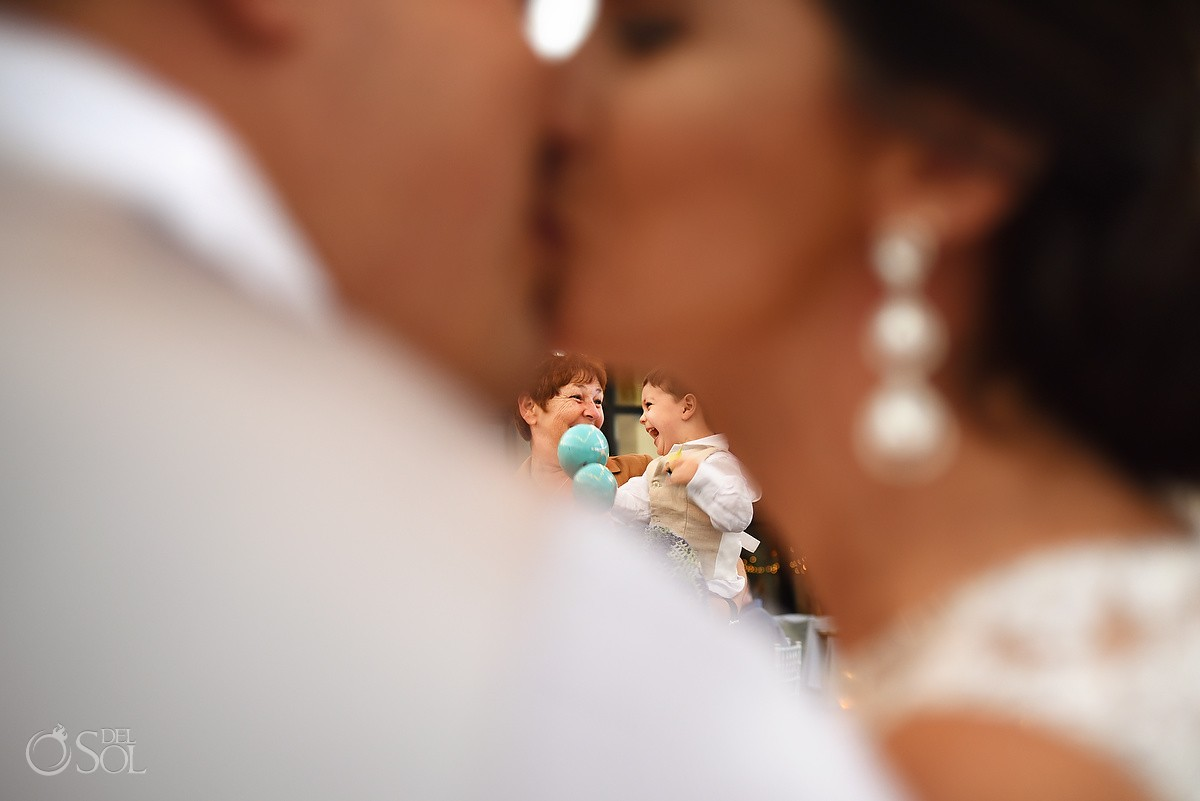 bride groom kiss framing son, creative wedding photograph, Now Sapphire Tequila terrace, Puerto Morellos, Mexico