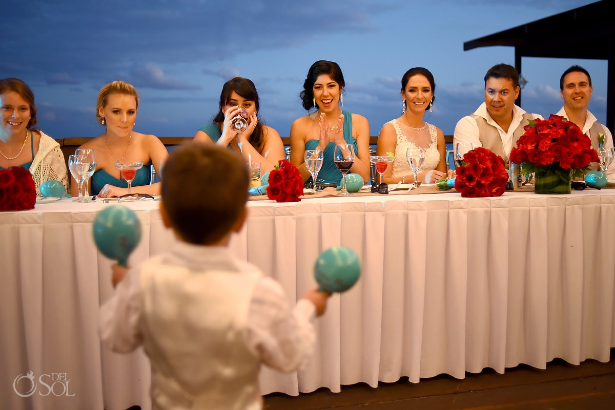 bride groom son playing maracas wedding party watching smiling, reception Now Sapphire Tequila terrace, Puerto Morellos, Mexico