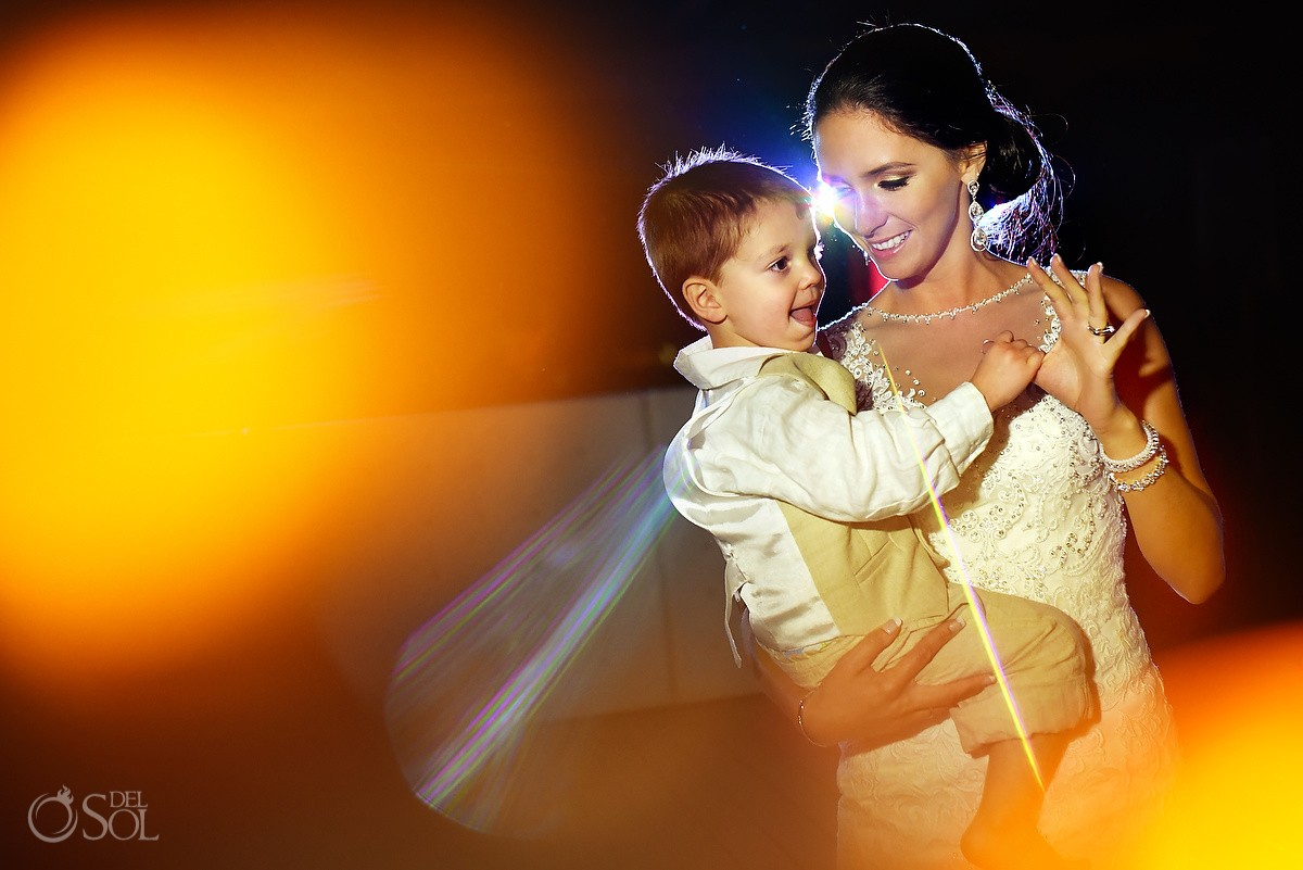 bride dances with baby son honor dead father, Wedding reception Now Sapphire Tequila terrace, Puerto Morellos, Mexico