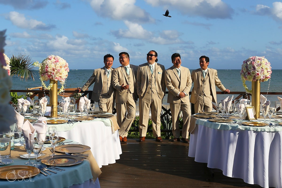 groom and groomsmen at Now Sapphire Riviera Cancun with bird