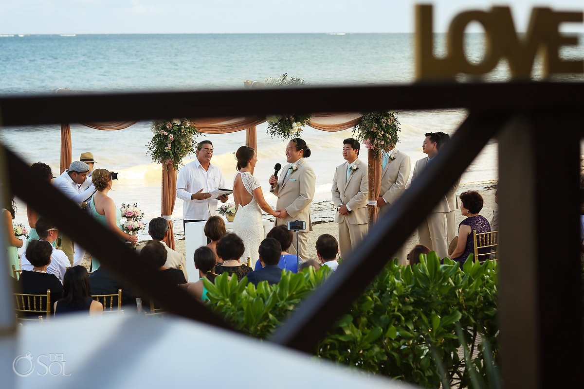 LOVE sign overlooking beach wedding at Now Sapphire Riviera Cancun hotel