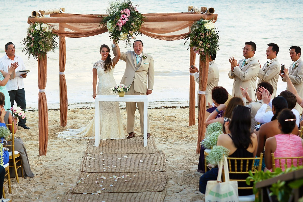 bride and groom celebrate during destination wedding at Now Sapphire Riviera Cancun