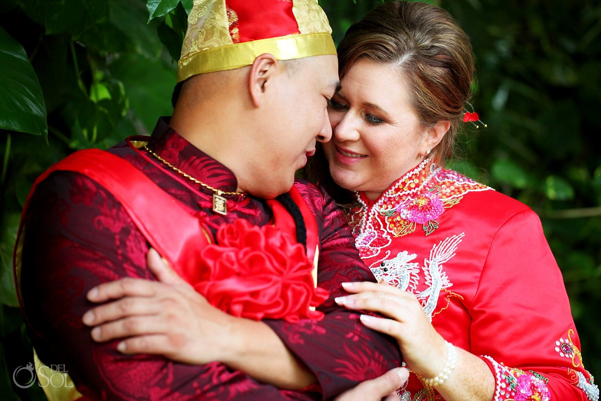 Chinese american couple wearing traditional tea ceremony outfit, Wedding Occidental Grand Xcaret, Playa del Carmen, Mexico