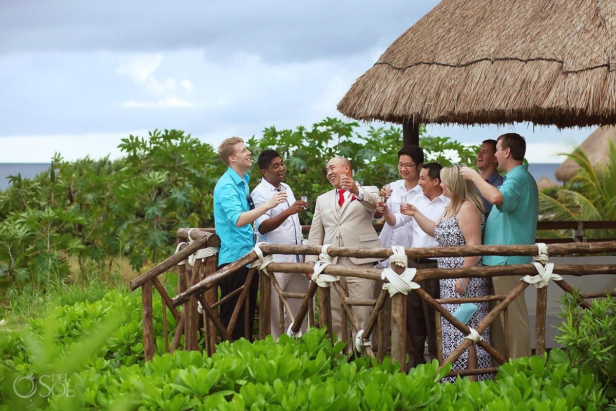 groom guests tequila shots ocean palapa, Wedding Occidental Grand Xcaret, Playa del Carmen, Mexico