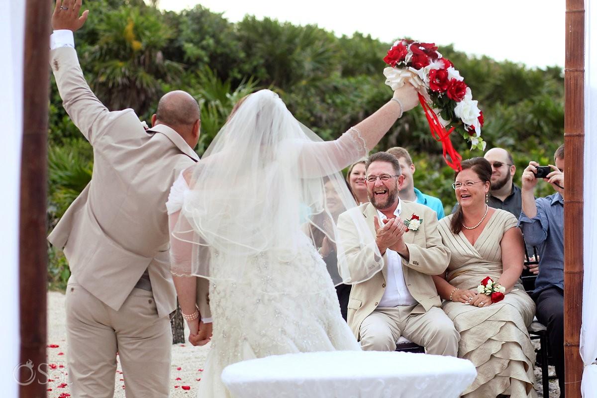 bride groom celebration ceremony exit guests parents cheering, Wedding Occidental Grand Xcaret, Playa del Carmen, Mexico