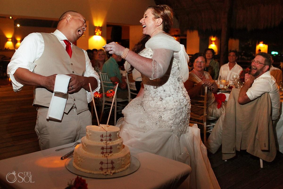 Cake smash funny wedding picture, reception, Occidental Grand Xcaret, Playa del Carmen, Mexico