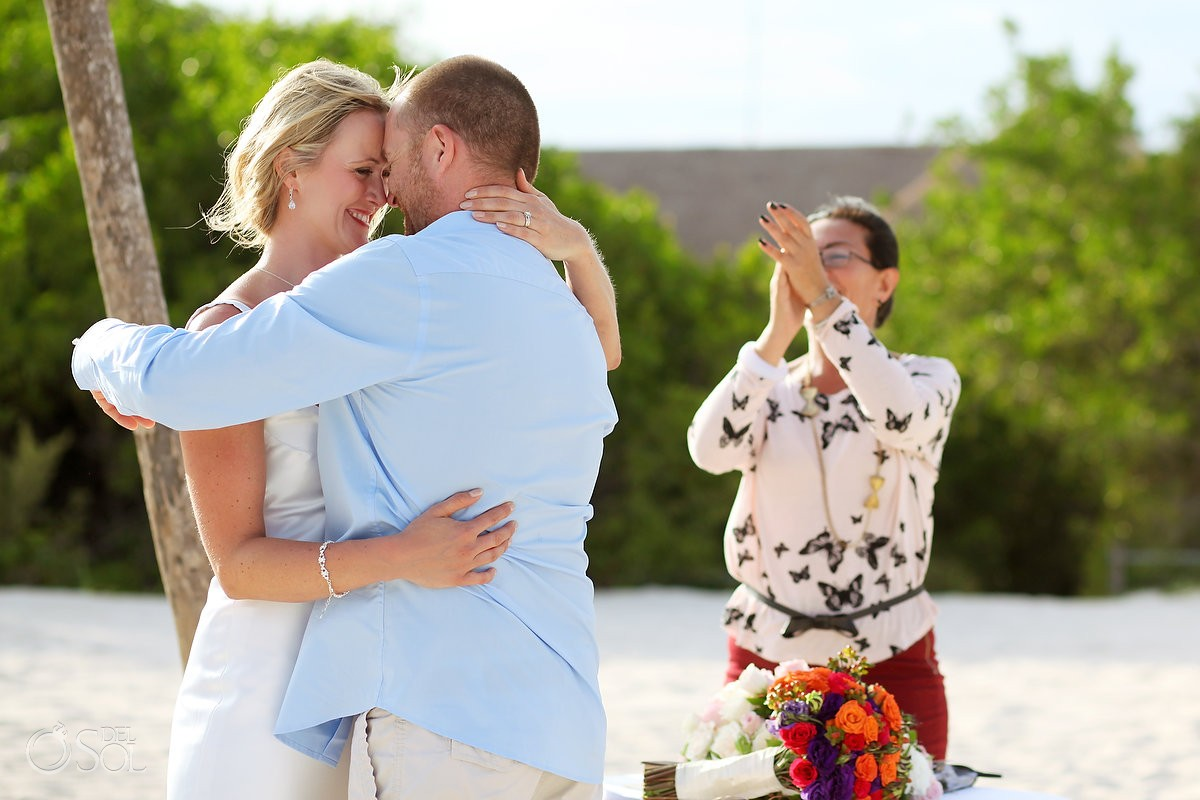 first kiss officiant clapping, beach Elopement Paradisus, Playa del Carmen, Mexico