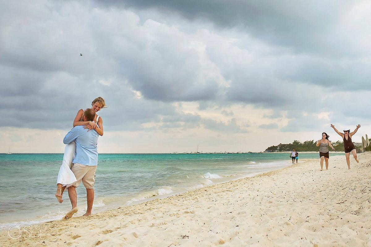 groom lifts bride photobomb lady, beach wedding portrait, Elopement Paradisus, Playa del Carmen, Mexico